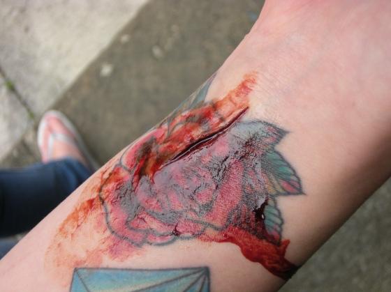 Wrist cut on top of tattoo